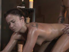 Oiled brunette sucking and...
